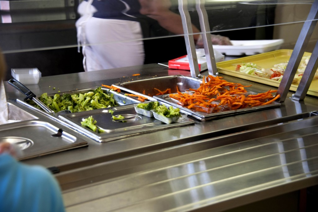 Focusing on the lunch line operated by cafeteria custodians