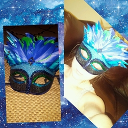 Teenage girl wearing a blue and black mask with large blue feathers on top